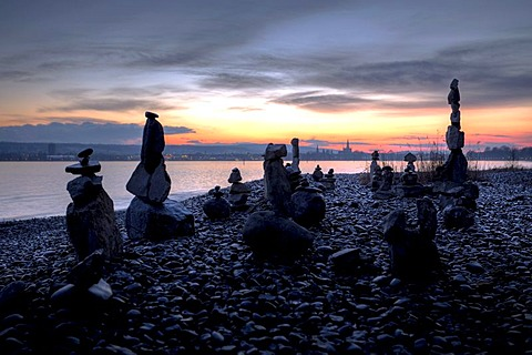 Cairns on the shores of Lake Constance, with the Cathedral of Constance in the evening light, Baden-Wuerttemberg, Germany, Europe