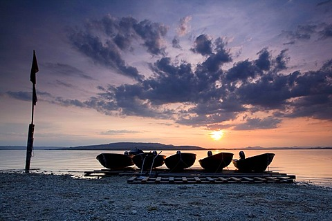 Boats in the evening light with sunset at Sandseele on Reichenau island,