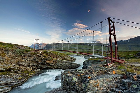 Midnight sun and an old suspension bridge in the Tjaekta Valley, Kungsleden, The King's Trail, Lapland, Sweden, Europe