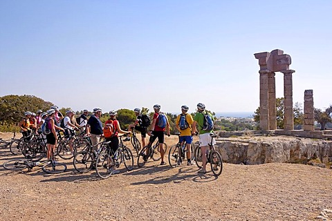 Cyclists at the Temple of Apollo, above Rhodes Town, Island of Rhodes, Greece, Europe