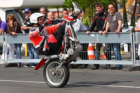 Stuntman Mike Auffenberg driving a trial motorcycle without a front wheel, Koblenz, Rhineland-Palatinate, Germany, Europe