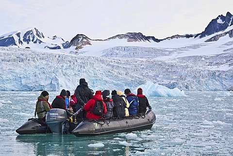 Ice, fjord, Zodiac rubber boat in the Fuglefjord in front of a glacier, Svalbard, Spitsbergen, Norway