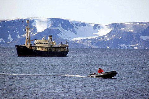 Cruise ship, Zodiac rubber boat in front of a ship, Svalbard, Spitsbergen, Norway