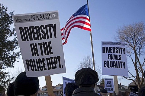 Residents rally at City Hall, asking that the city establish a citizens review board to monitor the police and increase the police force's diversity, Hamtramck, Michigan, USA