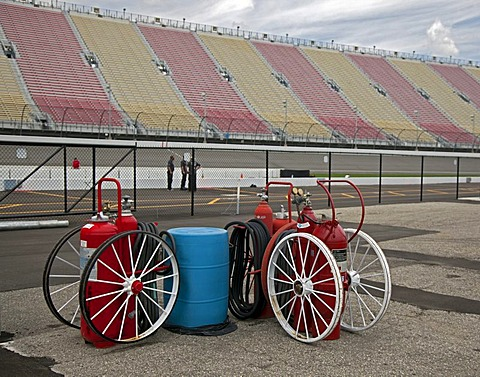 Fire extinguishers on wheels at Michigan International Speedway which features a two-mile race track and seats nearly 120, 000 fans for NASCAR races, Brooklyn, Michigan, USA, America