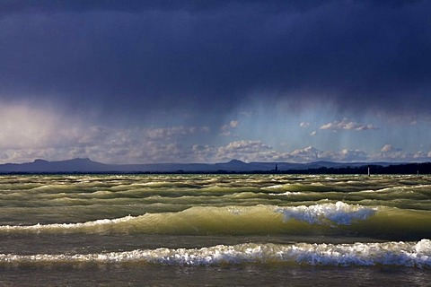 Storm Xynthia causing high waves on the shore of Reichenau island and rain, looking towards Radolfzell, Lake Constance, Untersee lake, Landkreis Konstanz county, Baden-Wuerttemberg, Germany, Europe