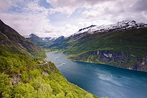 View of the Geiranger Fjord from the eagle eyes view ornesvingen with the town of Geiranger and the ferry to Hellesylt, Norway, Scandinavia, Europe