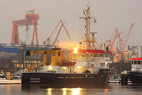 Harbor view with the ship of the maritime police, crane of the North Sea Works in the back, Emden, East Frisia, Lower Saxony, Germany, Europe