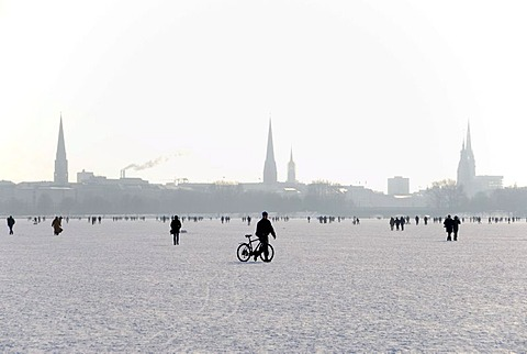 Pedestrians on the frozen Aussenalster lake in Hamburg, Germany, Europe