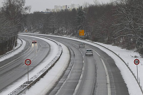 Snow covered B448 highway near Offenbach-Bieber with 120kmh speed limit signs, Hesse, Germany
