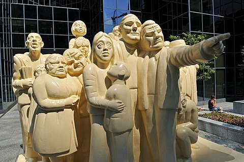Illuminated Crowd Sculpture by Raymond Masson, in front of a skyscraper, downtown Montreal, Quebec, Canada, North America