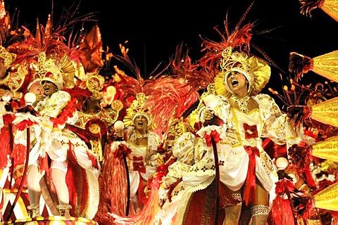 Samba dancers on an allegorical float of the Beija-Flor de Nikopol samba school at the Carnaval in Rio de Janeiro 2010, Brazil, South America