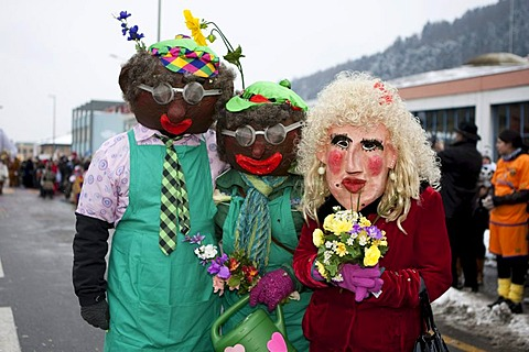 Colourful masks during the carnival procession in Littau, Lucerne, Switzerland, Europe