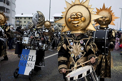 Guggenmusik Noelli Groetze group dressed to the theme of Sole Luna, Sun and Moon, during the carnival procession in Littau, Lucerne, Switzerland, Europe