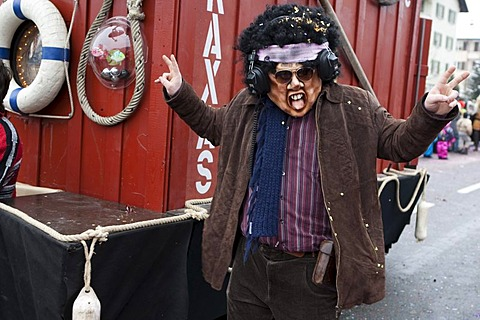 Kulturfasnaechtler Nexkraxas dressed as a pirate radio broadcaster during the carnival procession in Littau, Lucerne, Switzerland, Europe