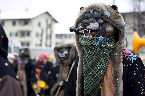 The Guggenmusik Ruopige Hoepfer group dressed in the theme of wolf tracks during the carnival procession in Littau, Lucerne, Switzerland, Europe