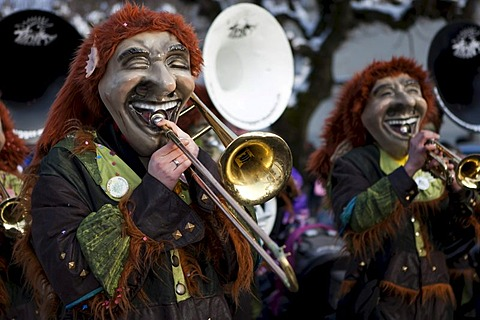 Guggenmusig Aemmerrugger group dressed to the theme of funny trolls during the carnival procession in Malters, Lucerne, Switzerland, Europe