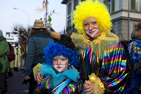 Colourful pair of clowns at the carnival procession in Malters, Lucerne, Switzerland, Europe