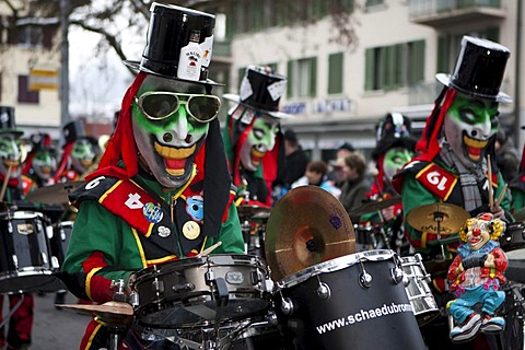 Guggenmusig Schaedubrommer group dressed to the theme of casino during the carnival procession in Malters, Lucerne, Switzerland, Europe