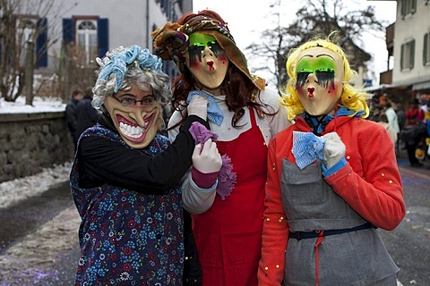 Colourful masks during the carnival procession in Malters, Lucerne, Switzerland, Europe