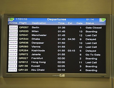 Departure board, Doha International Airport, Doha, Qatar, Asia