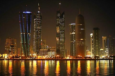 Night shot of the Doha skyline, Tornado Tower, Navigation Tower, Peace Towers, Al-Thani Tower, Doha, Qatar, Persian Gulf, Middle East, Asia