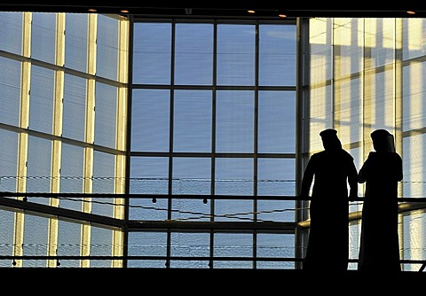 Qatari wearing traditional dress with gutra, inner shot of the atrium, Museum of Islamic Art, designed by I.M. PEI, Corniche, Doha, Qatar, Persian Gulf, Middle East, Asia