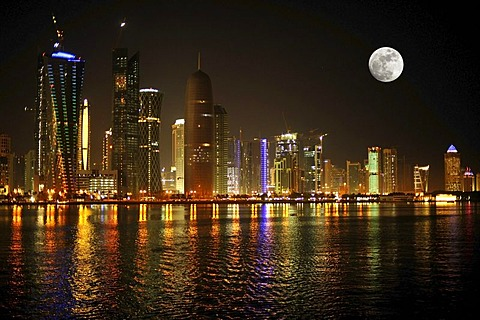 Night shot, Doha skyline with the Tornado Tower, Navigation Tower, Peace Towera, Al-Thani Tower and the moon, Doha, Qatar, Persian Gulf, Middle East, Asia