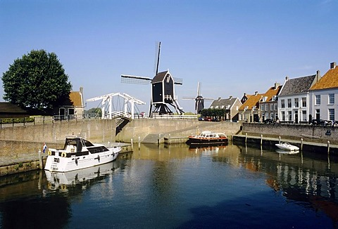 Romantic port with windmill, old fortified town of Heusden on the Maas river, North Brabant, Holland, Netherlands, Europe