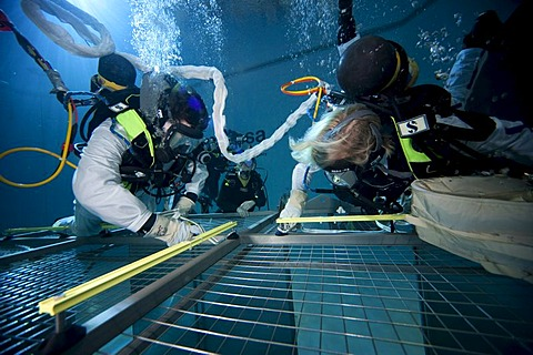 Backup divers and astronauts practicing with a space station module reproduction in a diving basin, European Space Agency, ESA, European Astronaut Center, EAC, Cologne, North Rhine-Westphalia, Germany, Europe