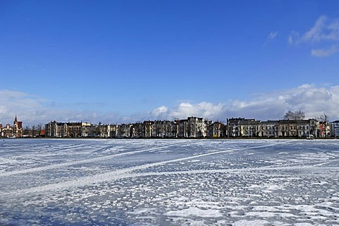 Frozen Pfaffenteich lake, in the back stately town mansions, August-Bebel-Strasse, Schwerin, Mecklenburg-Western Pomerania, Germany, Europe