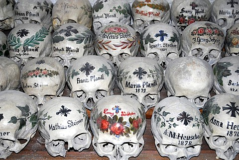 Painted skulls at the churchyard bone house, Catholic church, Hallstatt at the Hallstaetter See, Lake Hallstatt, UNESCO World Heritage Site, Salzkammergut, Alps, Upper Austria, Europe