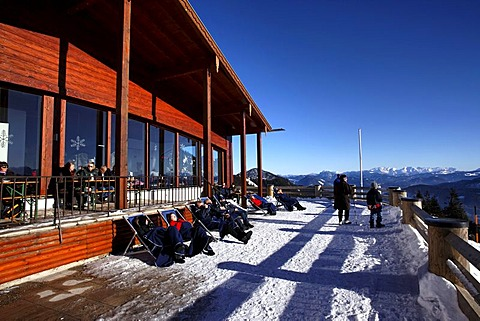 People enjoying the sun on the Sonnen Alm restaurant terrace, Kampenwand, Chiemgau, Upper Bavaria, Germany, Europe