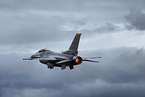 F-16 Fighting Falcon under full thrust on take off, military aircraft