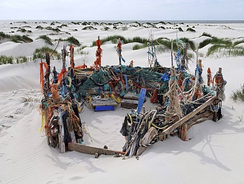 Beach castle built in sand dunes with driftwood and mmaterial washed up from the Sea between Nebel and Norddorf, Amrum Island, Schleswig-Holstein, Germany, Europe