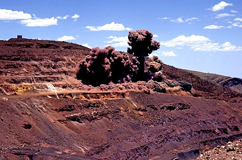 Blasting for iron ore, Hamersley iron ore mine, Tom Price, Pilbara, Western Australia, Australia