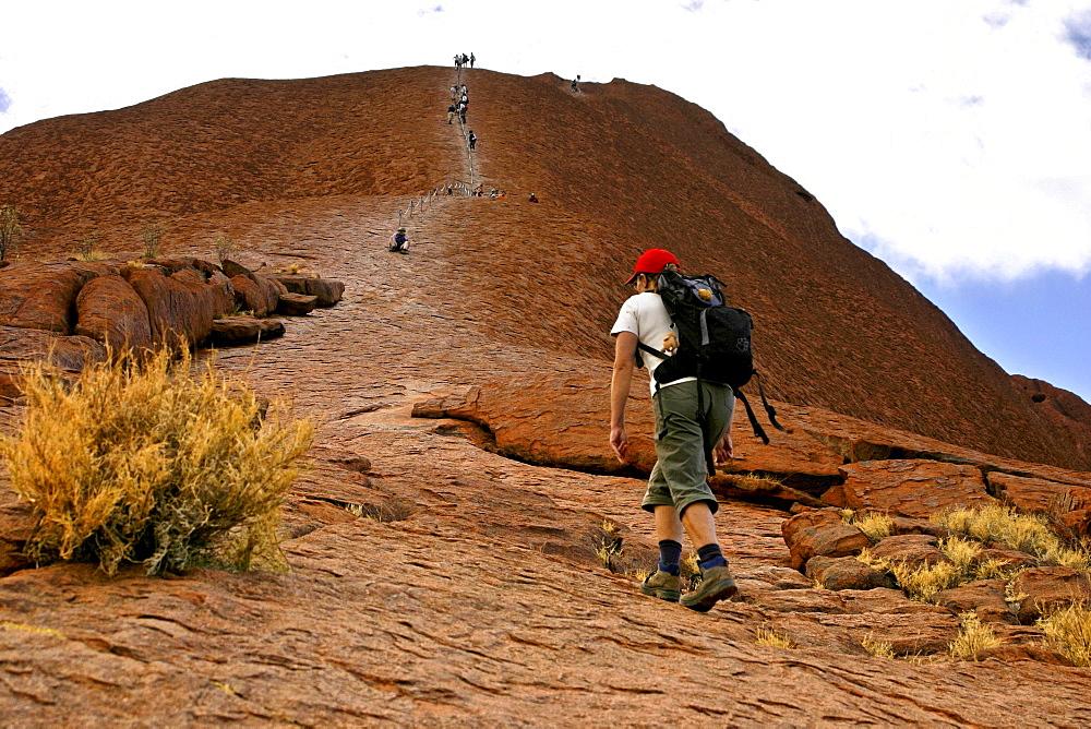 People climbing Uluru, Ayers Rock, Uluru National Park, Northern Territory, Australia