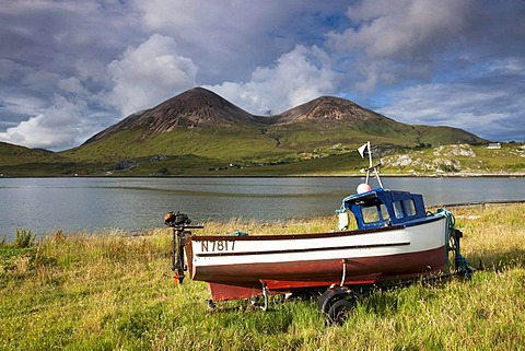 Fishing boat with mountains on the Isle of Skye, Highland Council, Scotland, United Kingdom, Europe