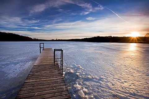 Ice-covered Mindelsee lake in the last evening light, Baden-Wuerttemberg, Germany, Europe