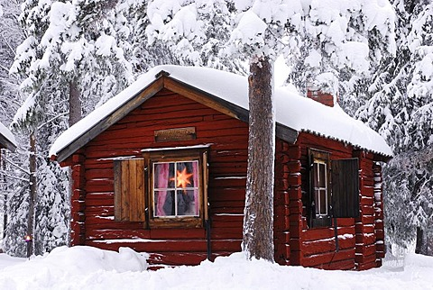 Cabin in the snow-covered forest, Gaellivare, Lappland, Sweden, Scandinavia, Europe