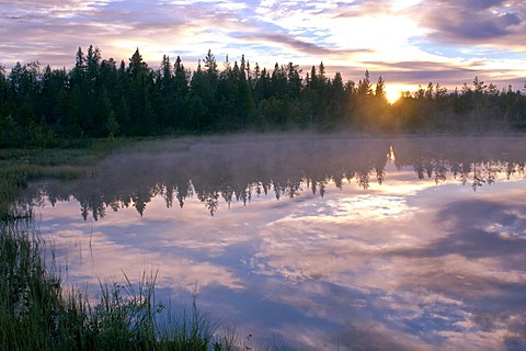 Sunset over a lake in Lapland, Sweden, Scandinavia, Europe