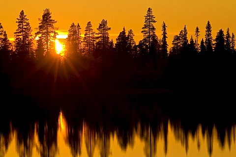 Sunset over a forest lake, Lapland, Sweden, Scandinavia, Europe