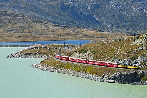 Rhaetische Bahn, Rhaetian Railway on the Bernina Pass, Lago Bianco lake, Engadin, Grisons, Switzerland, Europe