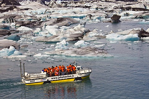 Amphibious vehicle with tourists on board on the Joekulsarlon glacial lake, Joekulsarlon, Vatnajoekull, Iceland, Europe