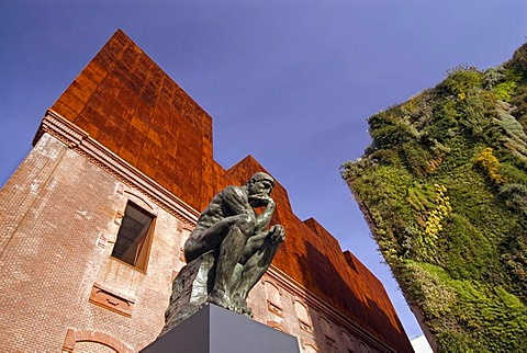 """Rodin's sculpture """"The Thinker"""" in front of the Caixa Forum Museum Art Center, Madrid, Spain, Europe"""
