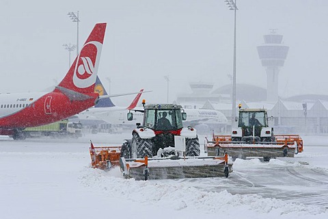 Snow, winter, snow removal with tractors, aircraft, taxiway, control tower, Terminal 1, west apron, Munich Airport, MUC, Bavaria, Germany, Europe