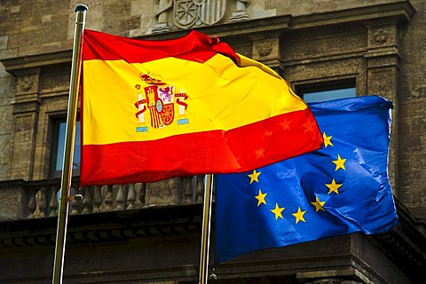 Spanish national flag and the flag of the European Union in front of the Spanish embassy in Berlin, Germany, Europe