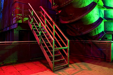 Colourfully lit staircase in the former steelworks, Landschaftspark Duisburg Nord landscape park, Ruhrgebiet area, North Rhine-Westphalia, Germany, Europe