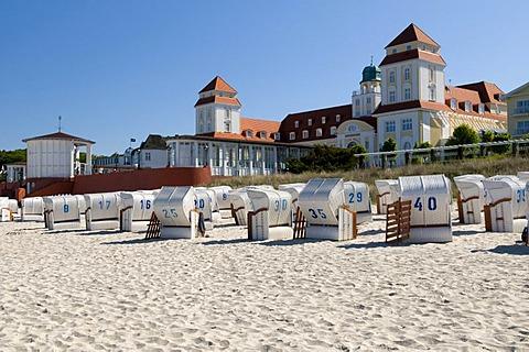 Roofed wicker beach chairs in front of Kurhaus, spa hotel in the Baltic Sea resort town of Binz, Isle of Ruegen, Mecklenburg-Western Pomerania, Germany, Europe