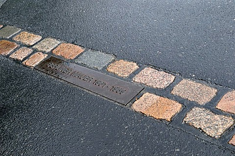 Cobble stones in the street marking the former course of the Berlin Wall, Berlin, Germany, Europe